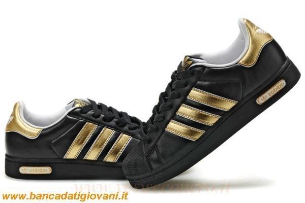 adidas nere con strisce oro