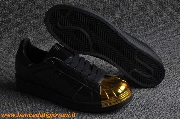 adidas nere punta oro